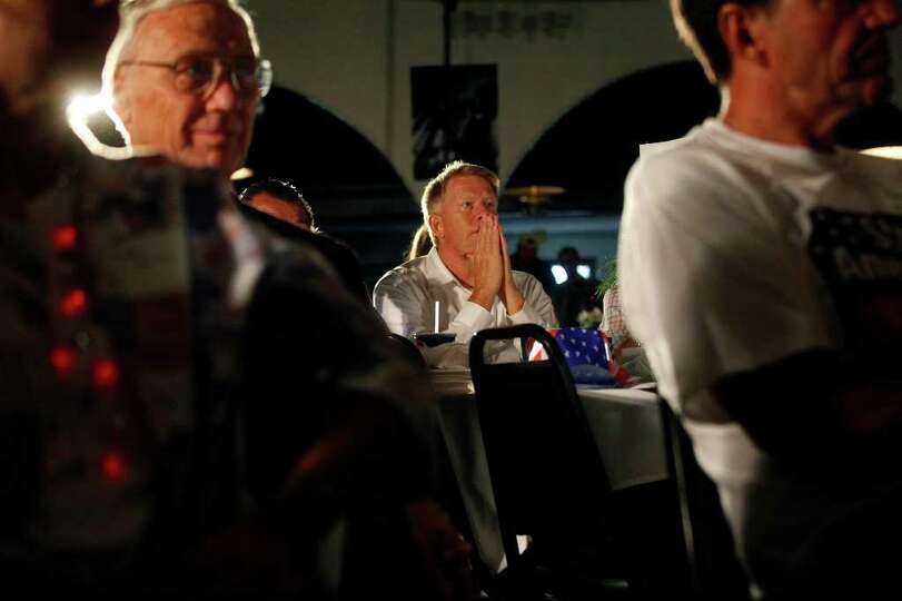 Metro - Dave Rust listens as Governor Rick Perry speaks during The Black Hawk County Lincoln Day Din