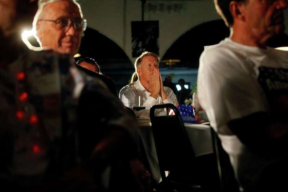 Metro - Dave Rust listens as Governor Rick Perry speaks during The Black Hawk County Lincoln Day Dinner in the Electric Park Ballroom at the National Cattle Congress in Waterloo, Iowa on Sunday, August 14, 2011. LISA KRANTZ/lkrantz@express-news.net / SAN ANTONIO EXPRESS-NEWS