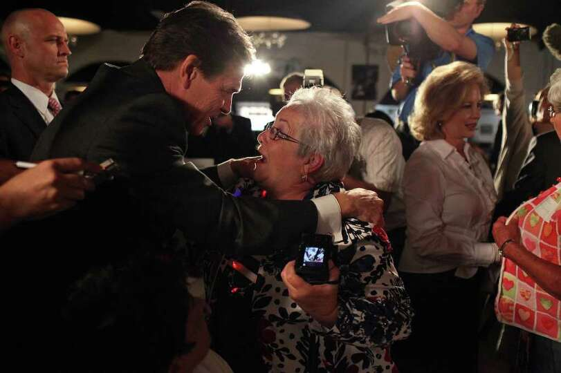 Metro - Linda Love of Cedar Falls, IA, greets Governor Rick Perry as he arrives for The Black Hawk C