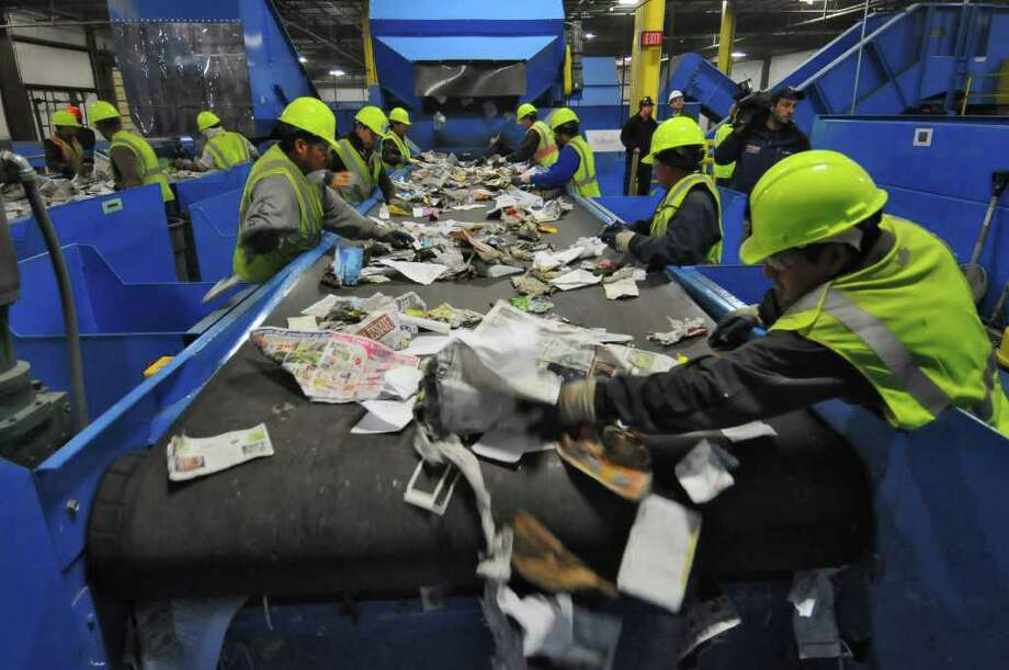 Workers sort through materials at County Waste and Recycling's new Single Stream Recycling Center in Albany, NY on Tuesday November 16, 2010. ( Philip Kamrass / Times Union ) Photo: Philip Kamrass / 00011081A
