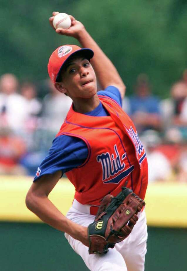 In 2001  Danny Almonte of the Bronx, lit up the Little League World  Series with a 70-mph fastball and a knee-buckling slider. Turns out  Almonte was really 14-years old at the time which was two years over the  age limit. Yer out! (AP Photo/Rusty Kennedy, File) Photo: Rusty Kennedy