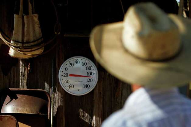 "Bobby Blaylock, County Commisioner and rancher, looks at his thermometer reading 110 degrees in the shade at his ranch home, Wednesday, Aug. 10, 2011, in Robert Lee.   ""I know that thermometer is correct,"" Blaylock said.  ""It's just a few weeks old.""  ""We take water for granted until it stops coming out of the faucet,"" Blaylock said.    The city of Robert Lee is experiencing an unprecedented drought receiving around 3 inches of rain in the past year.  The city's drinking water is nearly dried up coming from the local Lake E.V. Spence which is at .7% capacity.  Families have been forced to conserve water cutting back from 20,000 gallons per family per month to 3,000 to 4,000 gallons.  If the city continues to receive no significant rain fall, the city will run out of water by early 2012. Photo: Michael Paulsen, Michael Paulsen/Houston Chronicle / © 2011 Houston Chronicle"