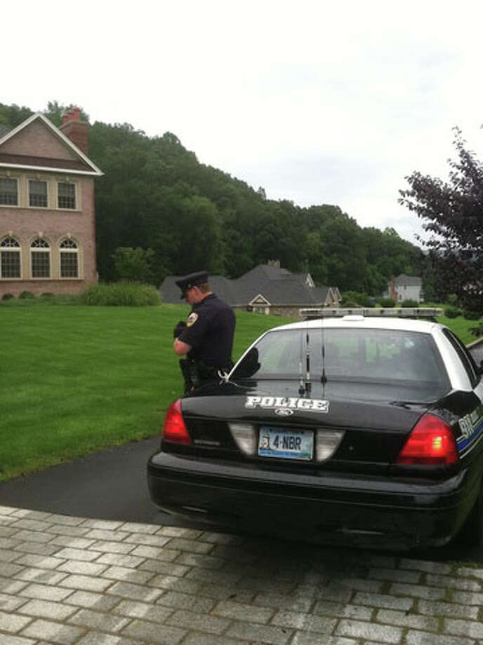 North Branford police stationed outside of an Autumn Court home that was the target of an armed robbery on Sunday, Aug. 14, 2011. Photo: Contributed Photo