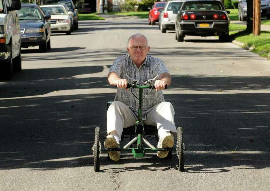 """Joe Fitzgerald on his quadricycle or """"Irish Mail""""  in Albany, NY Thursday Aug. 11,2011.( Michael P. Farrell/Times Union) Photo: Michael P. Farrell"""