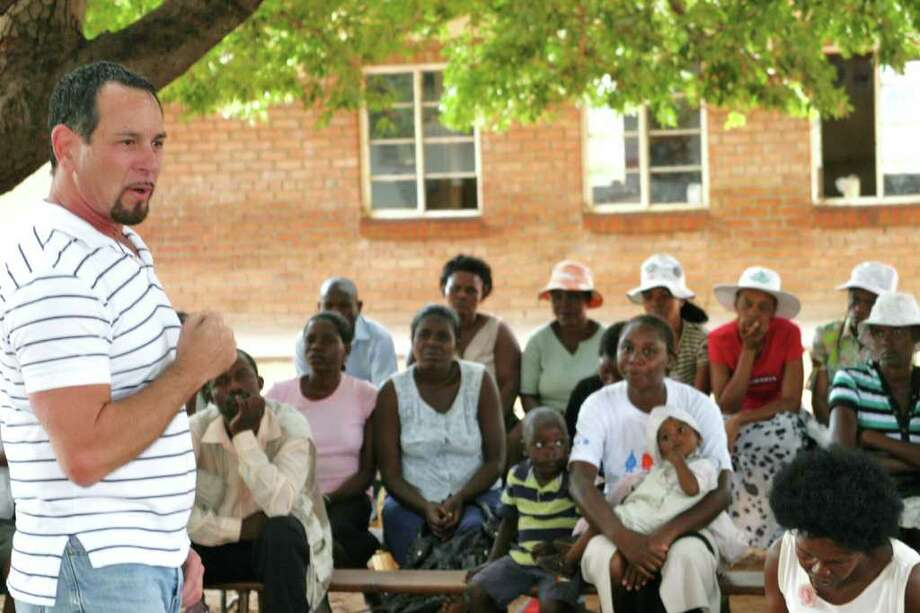 A group of Zimbabweans gives Gary Blick full attention as he explains the B.E.A.T. AIDS initiative and changing behavior to take precautions to prevent acquiring the HIV/AIDS virus. Photo: Contributed Photo