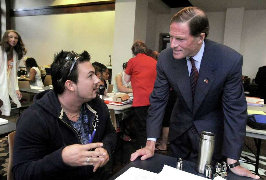 U.S. Sen. Richard Blumenthal, right, talks with Danbury teacher John Sincerbraux during a Connecticut Science Center program for area teachers held at Western Connecticut State University in Danbury Monday, Aug. 15, 2011. Photo: Michael Duffy / The News-Times