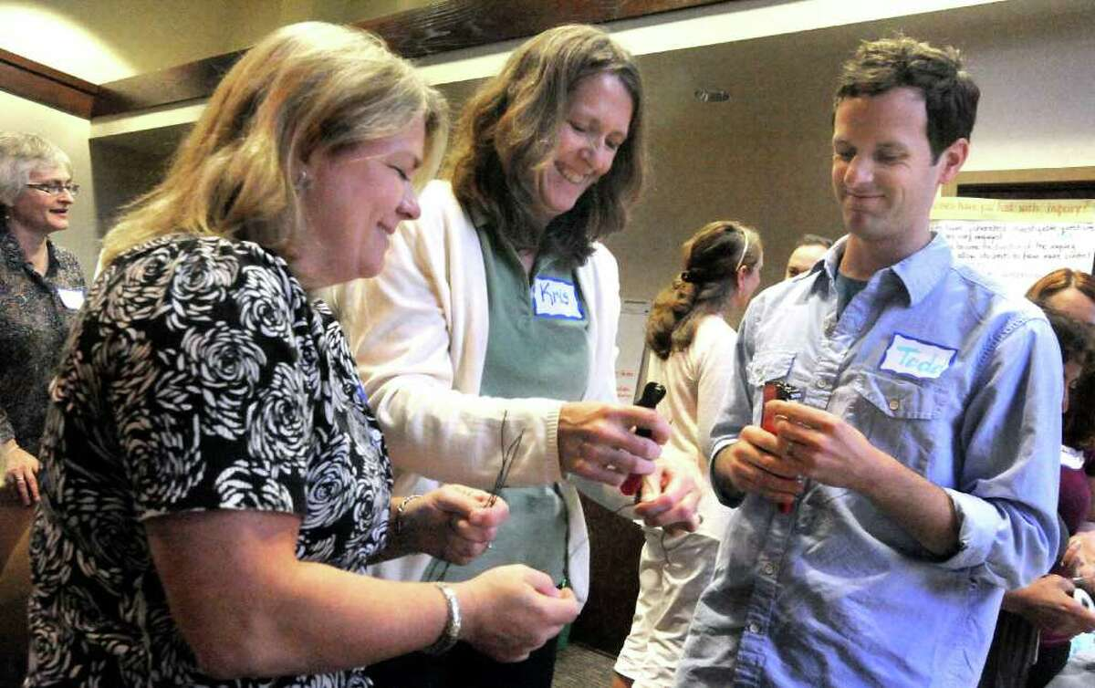 Susan Brofford, left, Kris Fed, and Todd Stentiford, cut wire for an electricity investigation during a Connecticut Science Center program for area teachers held at Western Connecticut State University in Danbury Monday, Aug. 15, 2011.