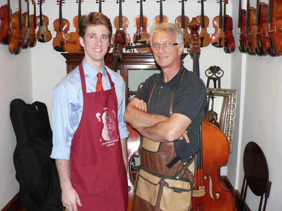 New Canaanite Stefan Sigurdsson, left, and mentor Constantin Popescu in luthier aprons. Photo: Contributed Photo