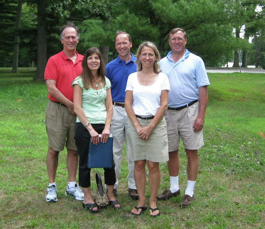 Ron Rosenfeld, co-owner of New Balance of New Canaan; Judi Anders, president of SPED*NET; Steve Karl, vice president of KARL Chevrolet; Denise Buckenheimer, vice-president of SPED*NET; and Steve Benko, Town of New Canaan recreation director. Photo: Contributed Photo