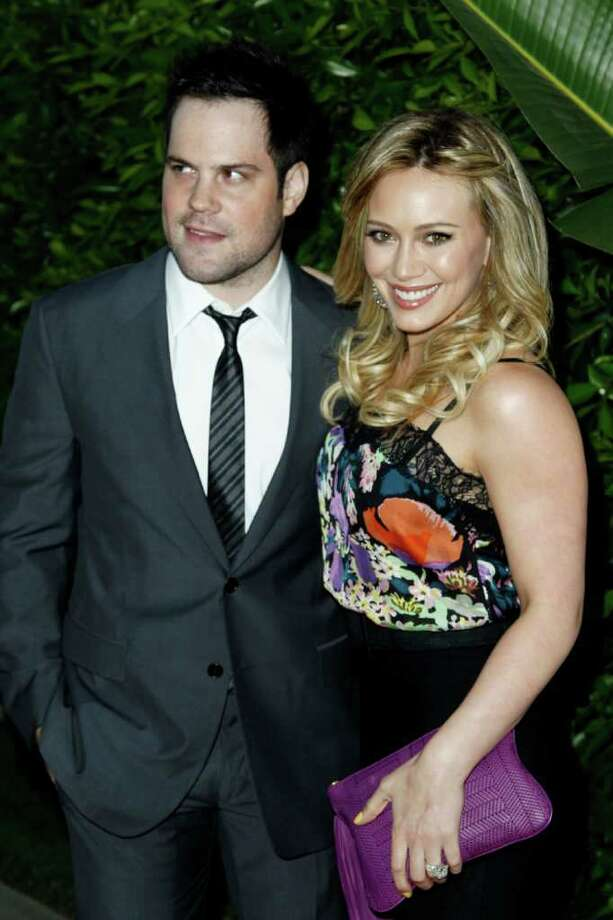 "FILE - In this May 11, 2011 file photo, actress Hilary Duff, right, and her husband Mike Comrie arrive at an Evening of ""Southern Style"" presented by The St. Bernard Project and the Spears Family in Beverly Hills, Calif. Duff announced in an Aug. 14, 2011 post on her official website that she is expecting a baby. (AP Photo/Matt Sayles, file) Photo: Matt Sayles"
