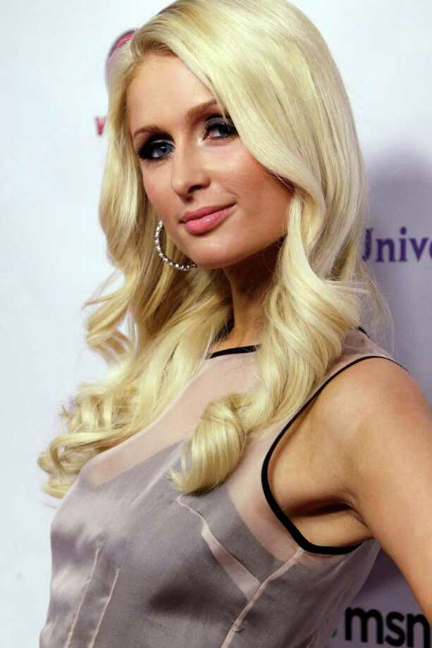 FILE - In this June 15, 2011 file photo, Paris Hilton arrives at the NBC Universal VIP party during the Cable Show in Chicago.  A Los Angeles judge ordered James Rainford to stand trial on a felony stalking charge filed after he was arrested outside the socialite's home July 4. (AP Photo/Nam Y. Huh, file) Photo: Nam Y. Huh