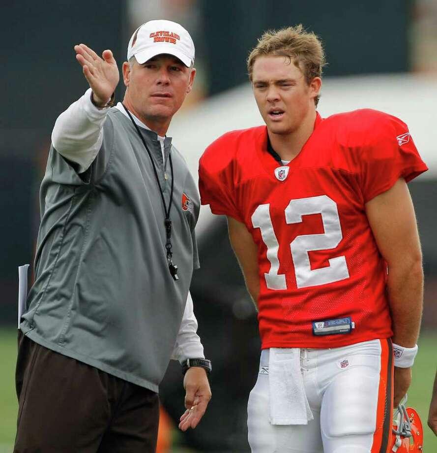 Cleveland Browns head coach Pat Shurmur talks with quarterback Colt McCoy at the teams' NFL football training camp in Berea, Ohio on Monday, Aug. 15, 2011.  (AP Photo/Amy Sancetta) Photo: Amy Sancetta, STF / AP