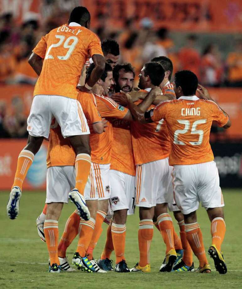 The Houston Dynamo celebrate after Adam Moffat scored a goal against the Portland Timbers in the first half of their soccer matchup at Robertson Stadium Sunday, Aug. 14, 2011, in Houston.  (Cody Duty / Houston Chronicle ) Photo: Cody Duty, Staff / © 2011 Houston Chronicle
