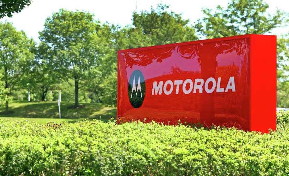 Motorola Mobility Holdings Inc. signage is displayed outside of the company's headquarters in Libertyville, Illinois, U.S., on Monday, Aug. 15, 2011. Google Inc.'s $12.5 billion deal to buy Motorola headlined another triple-digit rally on Wall Street Monday as experts predict large cap companies will unleash more cash to add product lines and grow revenues in the coming the months. Photographer: Tim Boyle/Bloomberg Photo: Tim Boyle, Bloomberg / © 2011 Bloomberg Finance LP