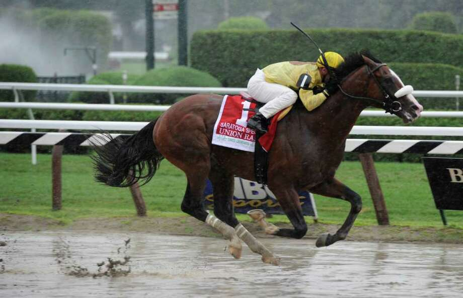 Union Rags with jockey Javier Castellano wins the Three Chimneys Saratoga Special which came with it a $200,000 bonus at the Saratoga Race Course in Saratoga Springs, N.Y.  Aug. 15, 2011.  (Skip Dickstein / Times Union) Photo: SKIP DICKSTEIN