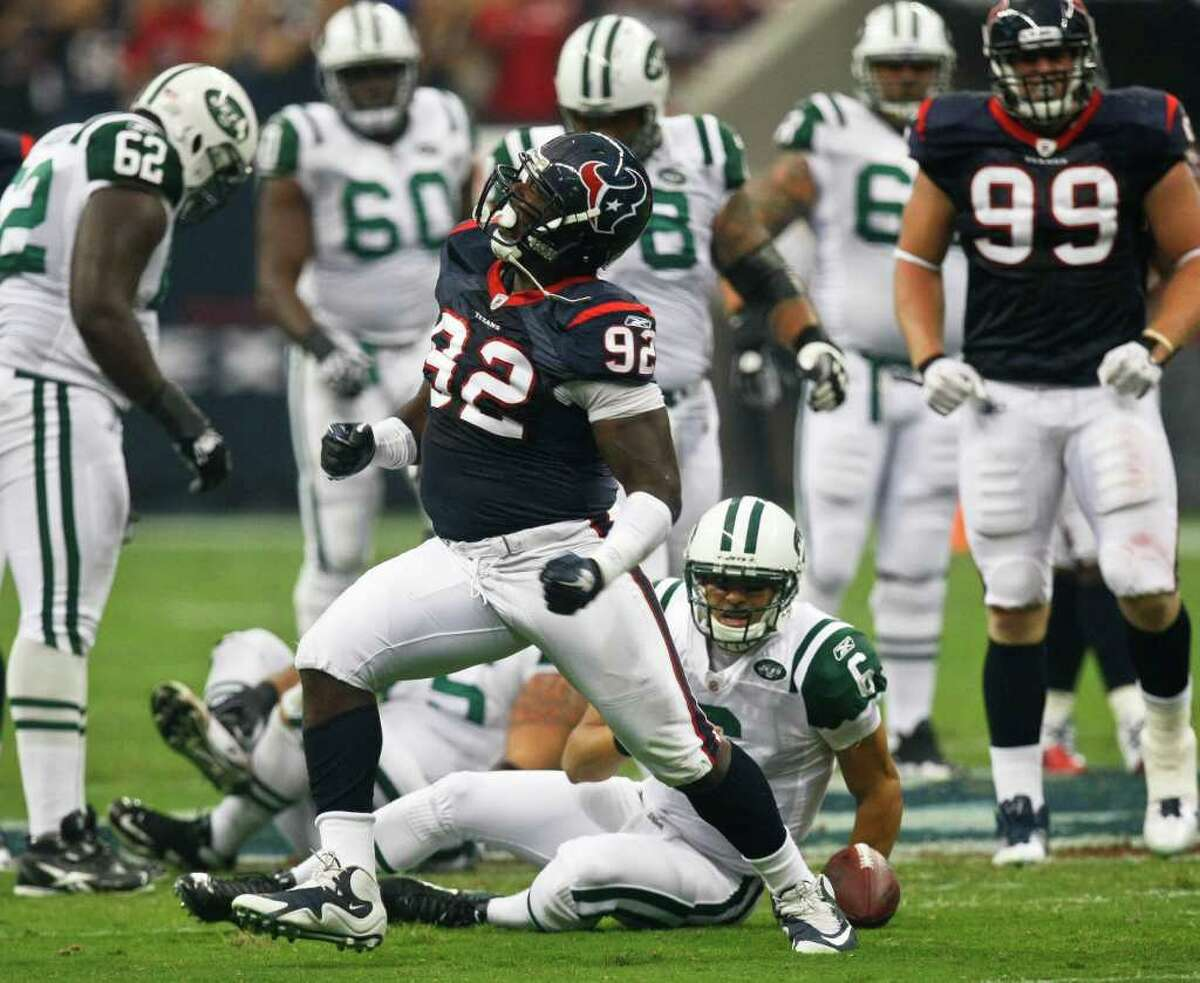 Houston Texans defensive tackle Earl Mitchell (92) reacts after sacking New York Jets quarterback Mark Sanchez (6) during the first half of the Houston Texans vs. New York Jets NFL preseason football game at Reliant Stadium Monday, Aug. 15, 2011, in Houston. ( Michael Paulsen / Houston Chronicle )