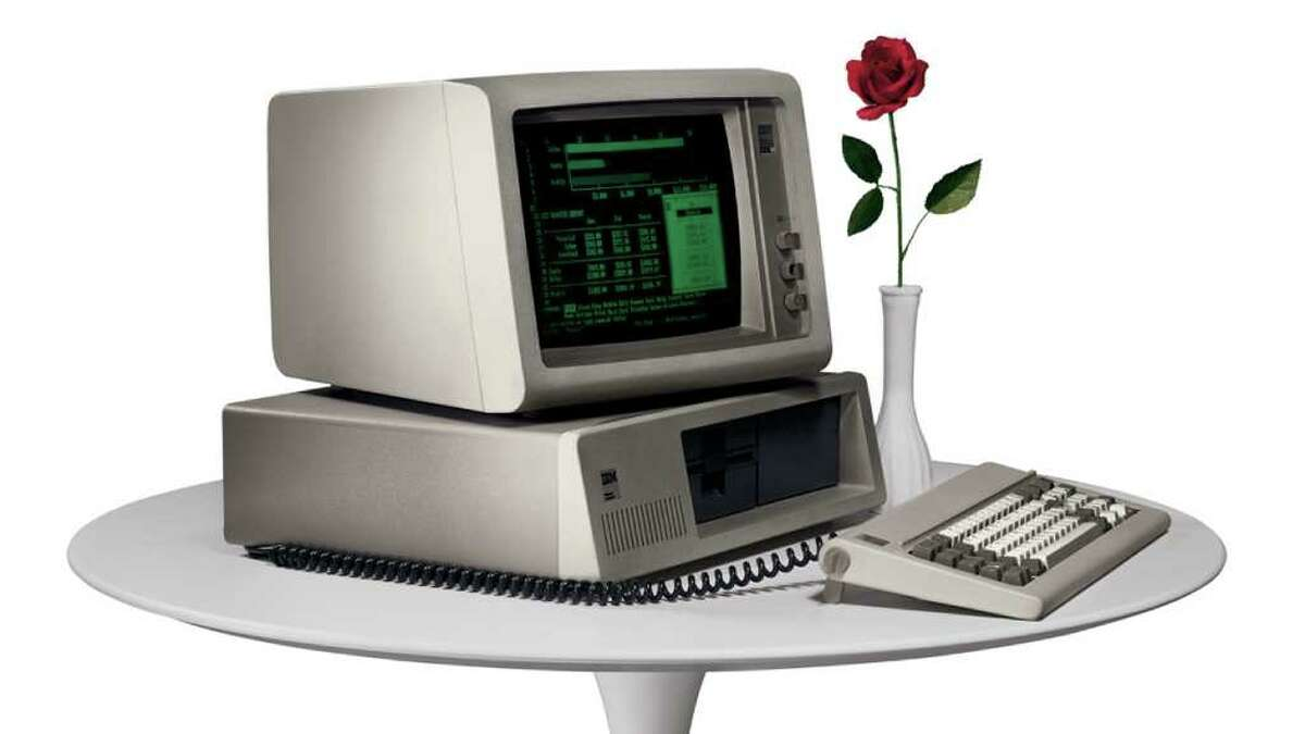 In this undated photo provided by International Business Machines Corp. (IBM) the IBM PC makes its debut in 1981. IBM was formed on June 16, 1911, as the Computing Tabulating Recording Co. in a merger of four separate companies. The new business with a plant in Endicott, N.Y., made scales, time clocks, cheese slicers and _ significantly for its future _ machines that read data stored on punch cards.(AP Photo/IBM Corporation)