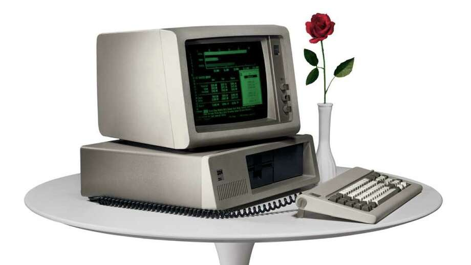 In this undated photo provided by International Business Machines Corp. (IBM) the IBM PC makes its debut in 1981. IBM was formed on June 16, 1911, as the Computing Tabulating Recording Co. in a merger of four separate companies. The new business with a plant in Endicott, N.Y., made scales, time clocks, cheese slicers and _ significantly for its future _ machines that read data stored on punch cards.(AP Photo/IBM Corporation) Photo: HOEP / IBM Corporation