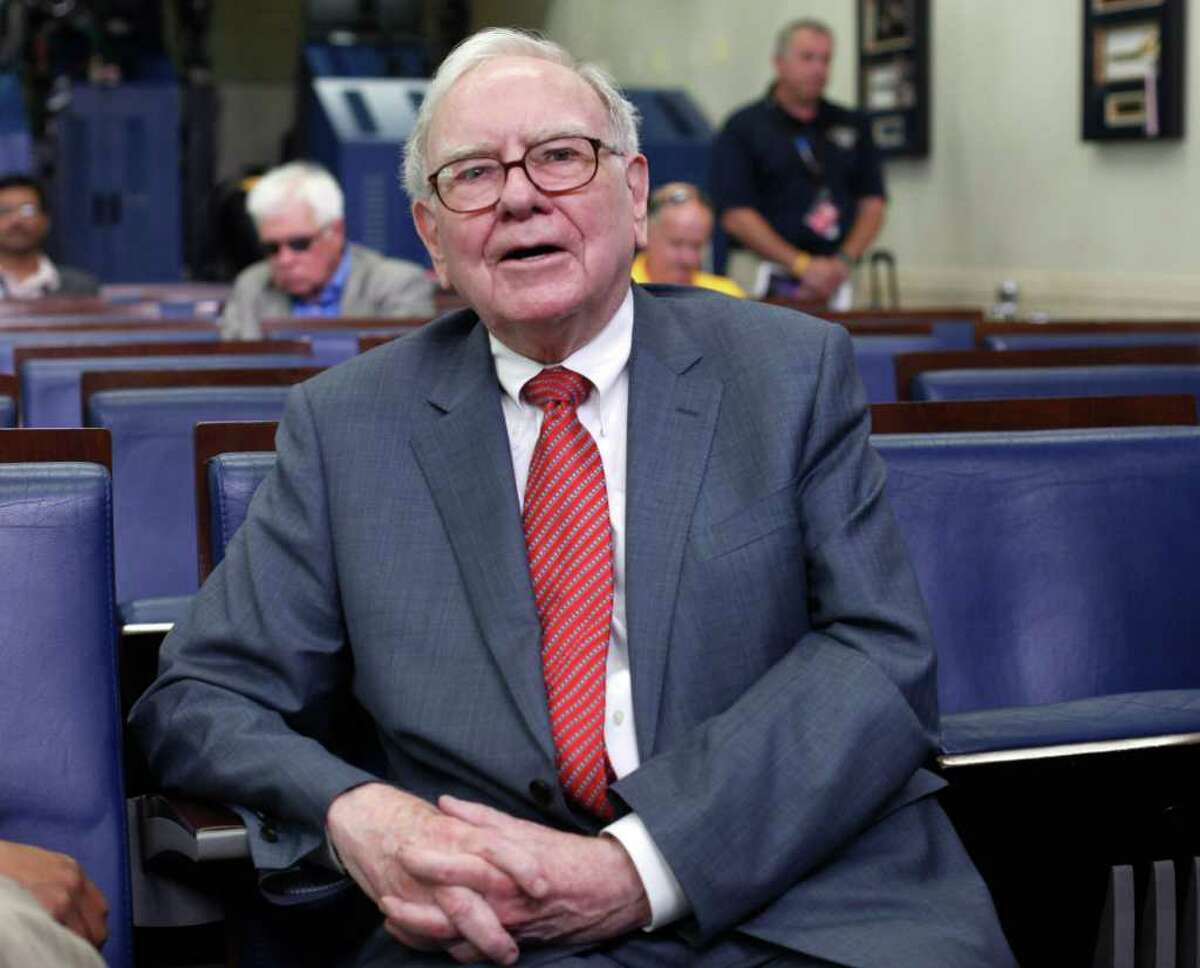 Warren Buffett is interviewed in the White House Briefing Room in Washington, Monday, July 18, 2011, following his meeting with President Barack Obama. Obama met with members of the Giving Pledge including, Buffett and Bill and Melinda Gates, and others to receive and update on the program. (AP Photo/Pablo Martinez Monsivais)
