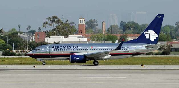An AeroMexico Boeing 737-700 waits on the runway as it prepare to take off from Los Angeles International Airport on April 5, 2011 in Los Angeles, California. Photo: Kevork Djansezian, Getty Images / 2011 Getty Images