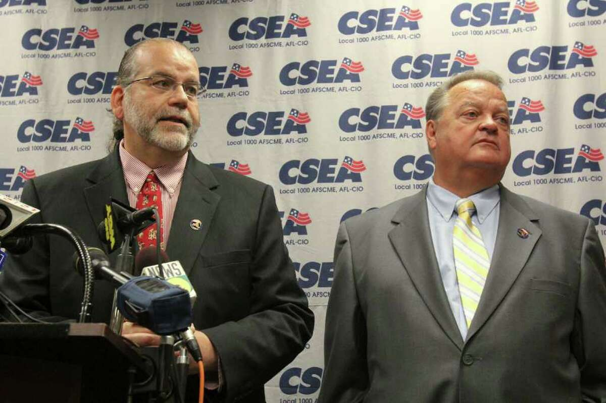 CSEA Director of Contract Administration Ross Hanna, ledt, and CSEA President Danny Donohue, right, discuss the ratification of a five year state contract at 143 Washington Ave., Albany on Tuesday, Aug. 16, 2011. (Erin Colligan / Special To The Times Union)
