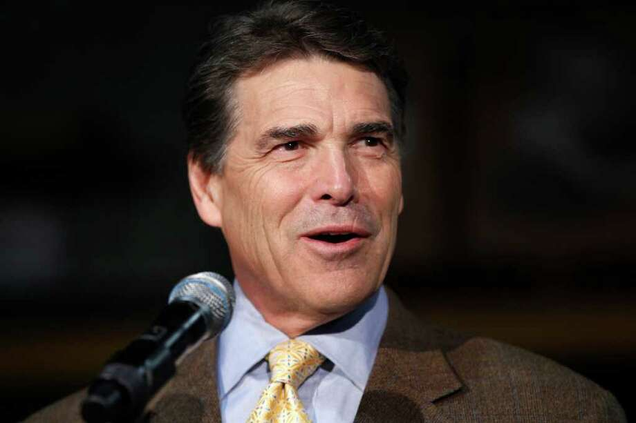 Republican presidential candidate, Texas Gov. Rick Perry speaks to workers as he makes a campaign stop at  D.C. Taylor Roofing in Cedar Rapids, Iowa,Tuesday, Aug. 16, 2011. Photo: AP