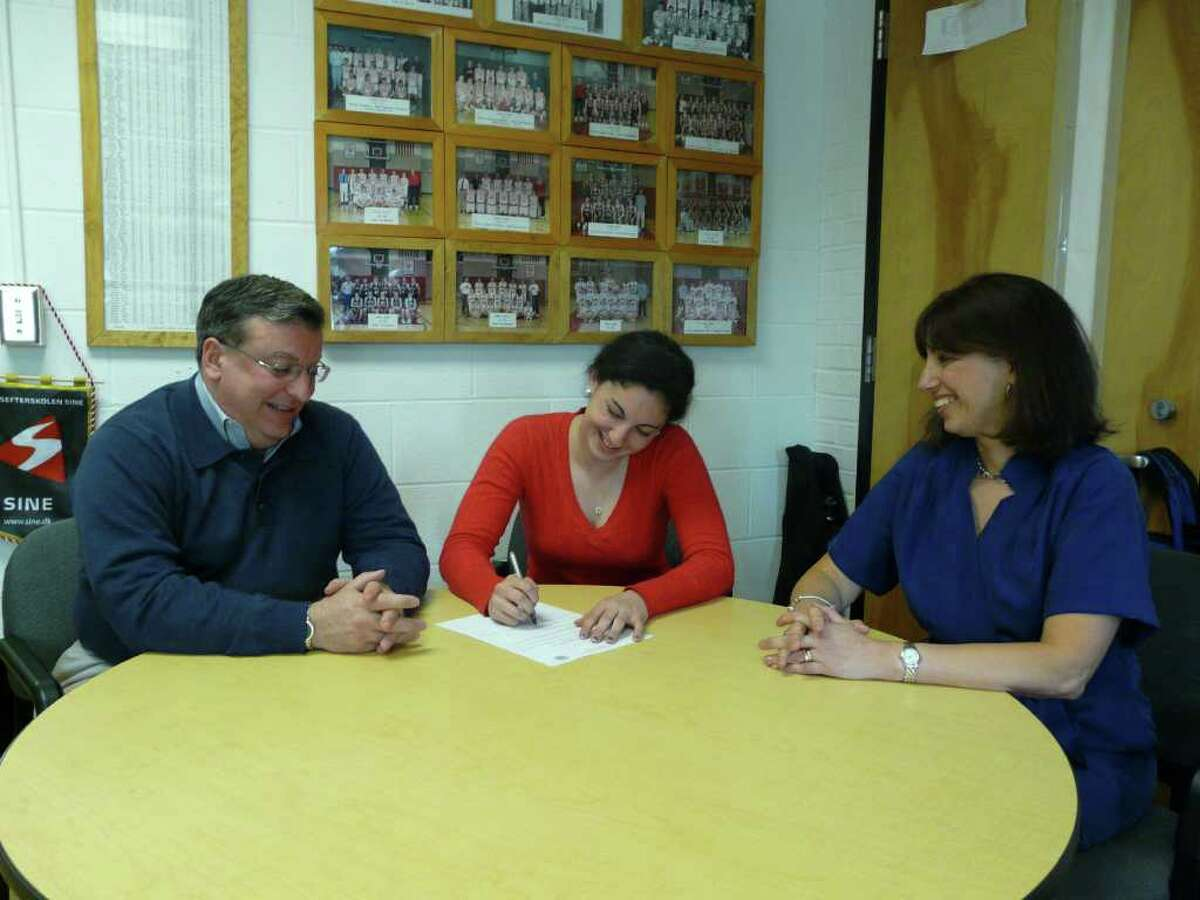 Fairfield Ludlowe's Elise Perazzini, middle, signs a National Letter of Intent to compete on the track team at Bucknell University. Perazzini, is joined by her dad, at right, Frank and mom, Pat.