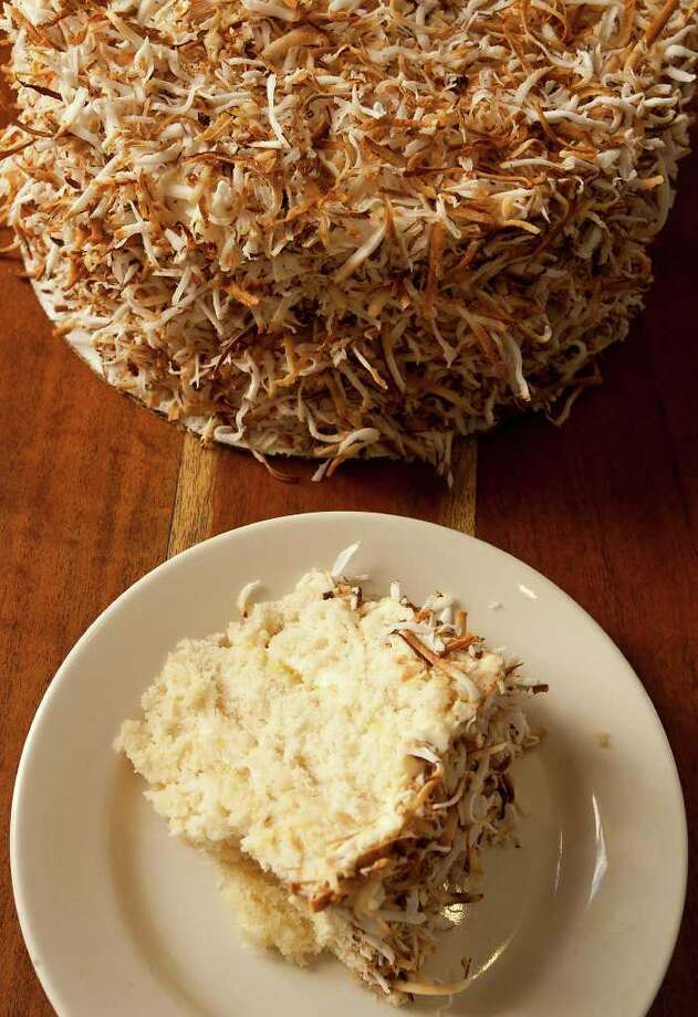 Coconut cake at Liberty Bar is a costumer favorite. The recipe was found on a Crisco label by owner Dwight Hobart's mother. Photo: SALLY FINNERAN, SAN ANTONIO EXPRESS-NEWS / sfinneran@express-news