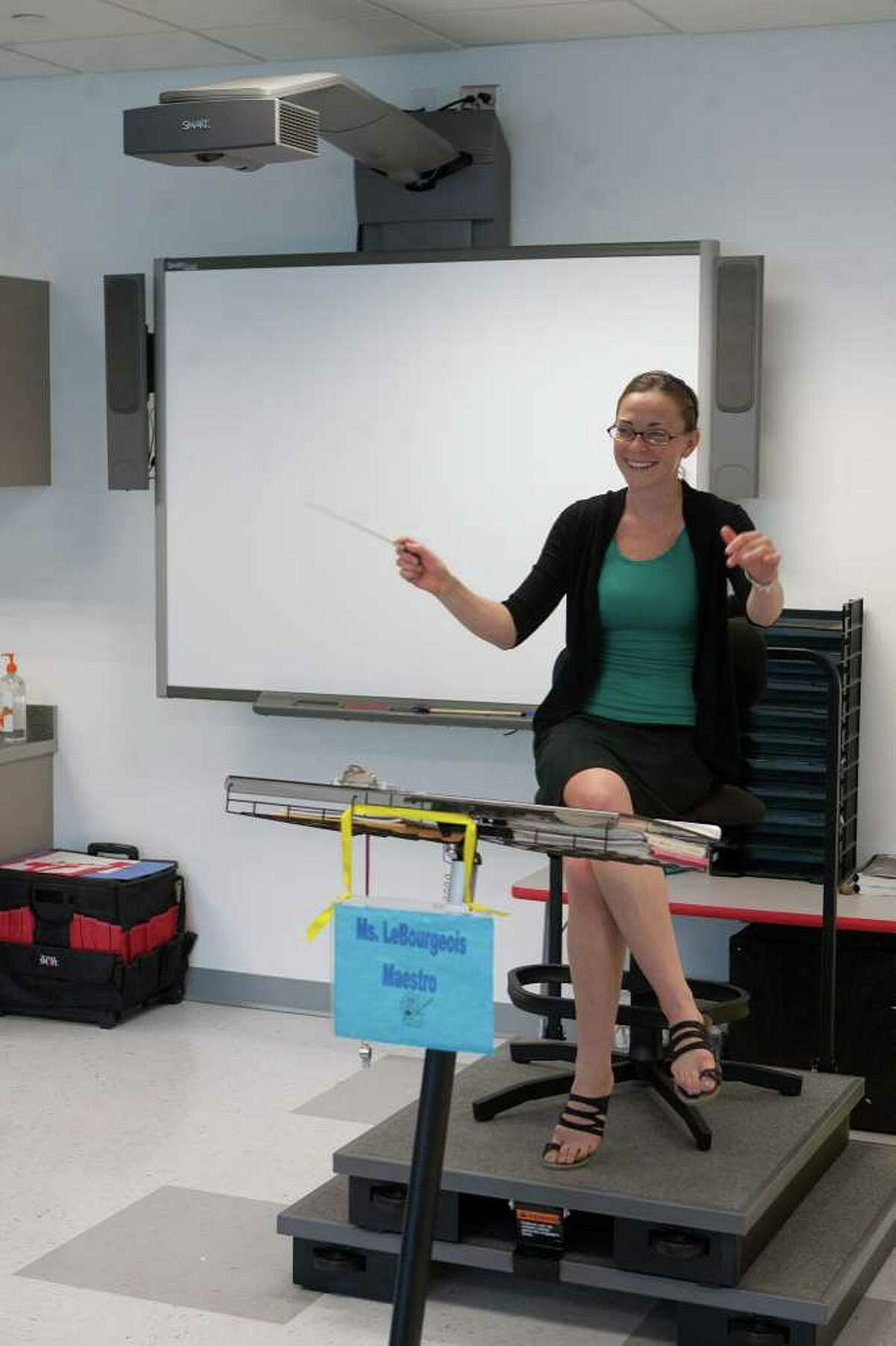 New: SmartBoard Sure it's just a glorified touch screen, but still - it beats the white board covered with slightly legible handwriting.Pictured: Orchestra teacher Colleen LeBourgeois warms up at the new Lovett Elementary School building in Houston.
