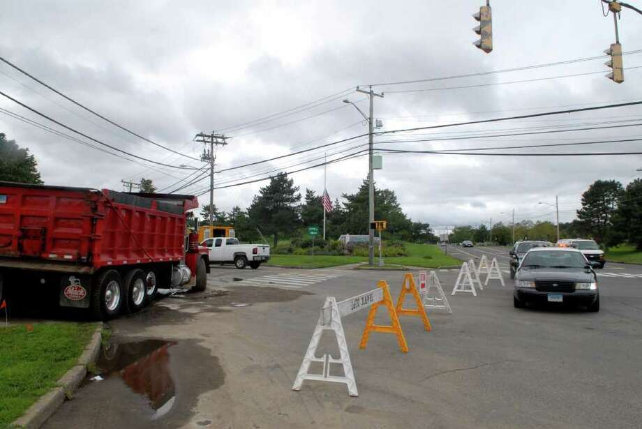 Workers from Penna Construction work on fixing a water main break near the intersection of Magee Avenue and Shippan Avenue in Stamford, Conn on Tuesday August 16, 2011, Shippan Ave was closed to traffic for the first 1/4 mile of the road. Photo: Dru Nadler / Stamford Advocate Freelance