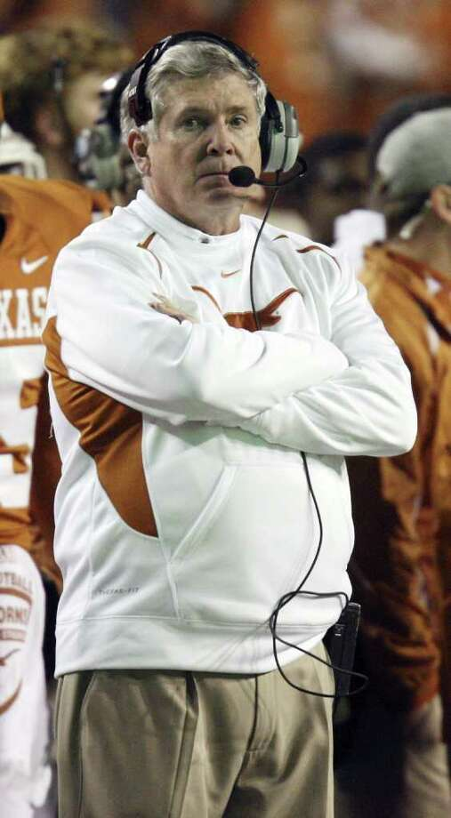 FOR SPORTS - Texas Longhorns' head coach Mack Brown watches action from the sidelines late in the game with the Oklahoma State Cowboys Saturday Nov. 13, 2010 at Royal-Memorial Stadium in Austin, Tx. The Oklahoma State Cowboys won 33-16.  (PHOTO BY EDWARD A. ORNELAS/eaornelas@express-news.net) Photo: EDWARD A. ORNELAS, Eaornelas@express-news.net / Beaumont