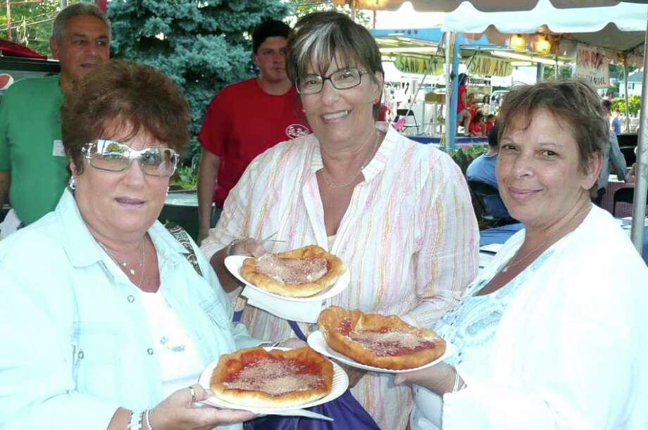 "Greenwich residents Kathleen Cicatelli, Anne Celipa, and Carmella Wauk enjoy their pizza frittas at the recent St. Roch feast in Chickahominy. ""We come here every year,"" said Cicatelli. Photo: Anne W. Semmes"