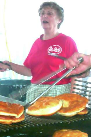 Looking over the pizza frita cooking process at the recent St. Roch feast was Maria Piu. She has been making the fan favorite at the feast for 45 years. Photo: Anne W. Semmes