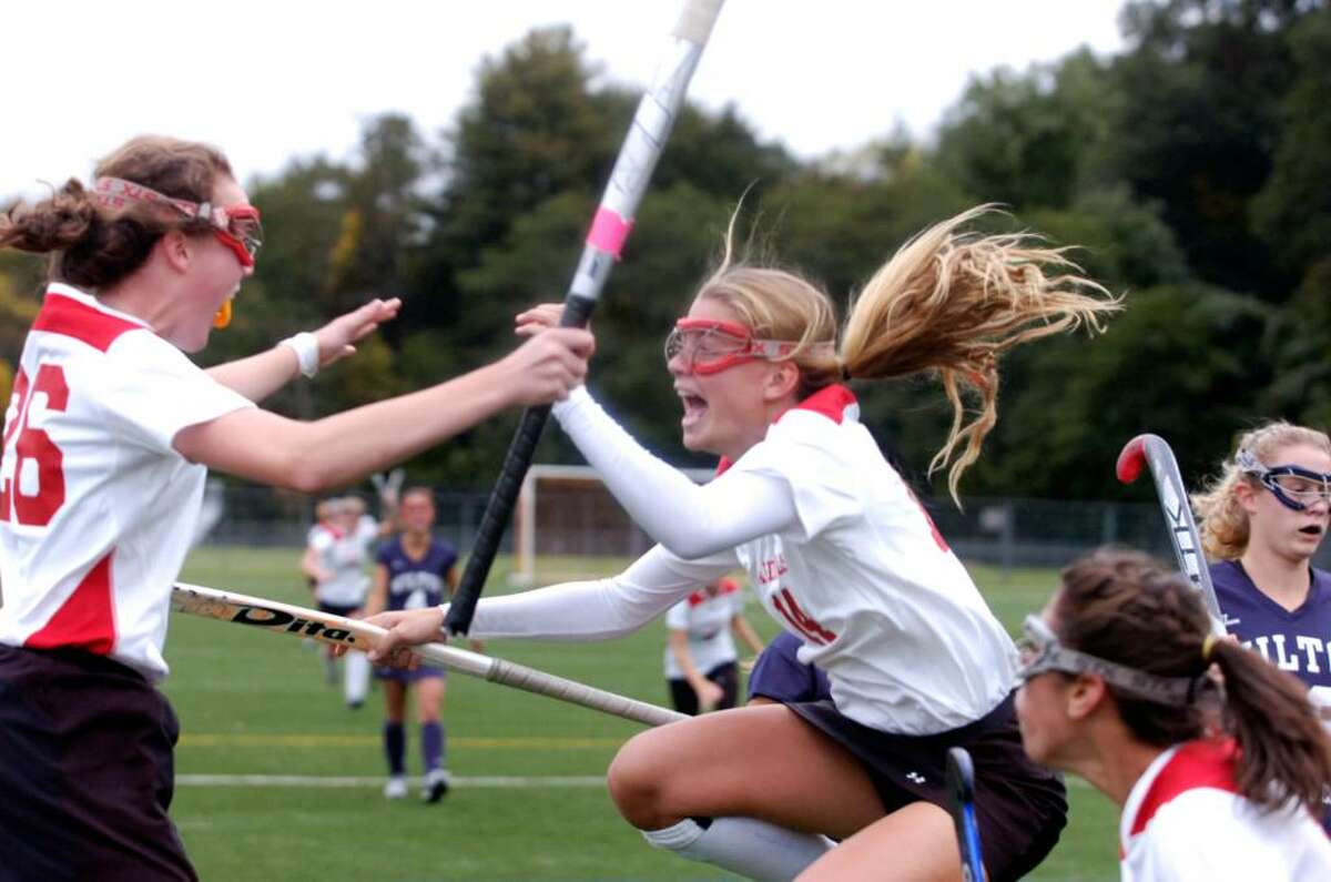 Claire Feeney, left, and Storm Kodde react to Feeney's goal during the first half as the Greenwich girls field hockey team hosts Wilton Wednesday afternoon, Oct. 14, 2009.
