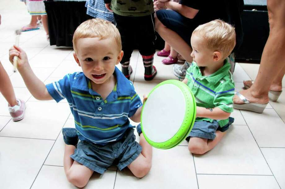 From left, Christopher Barry, 3, and Robert Barry, 3, of Danbury play drums at the Danbury Fair Summer Kidz Camp. The camp is held every Tuesday morning from 10am-12pm and will be running through August 23rd. Photo: Patricia Keeler / The News-Times