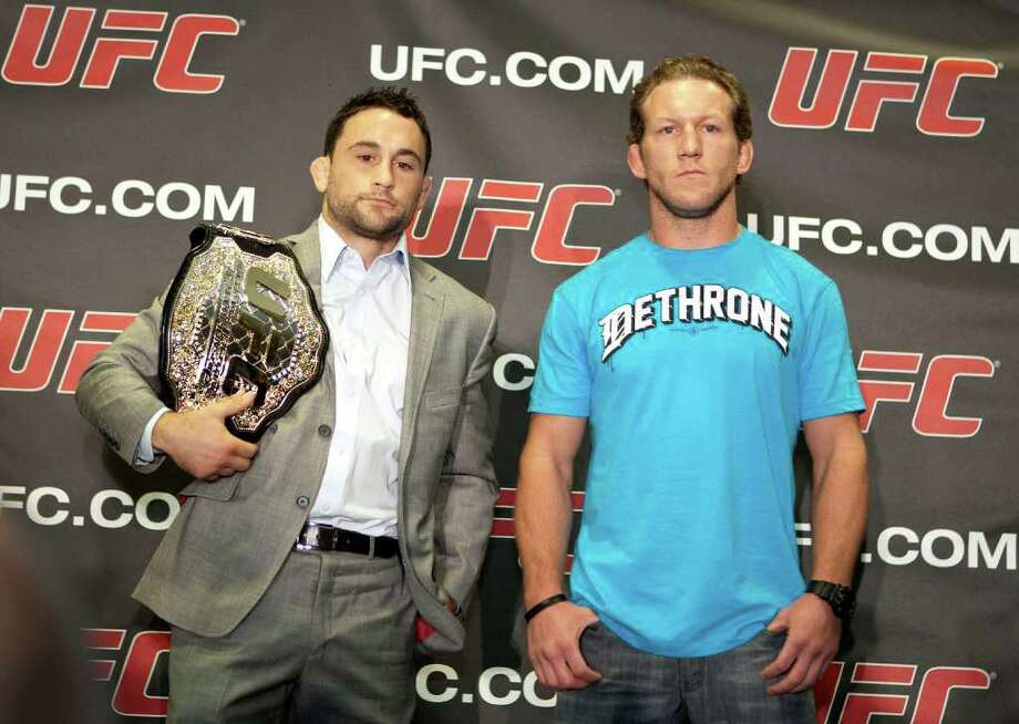 UFC (Ultimate Fighting Championship) UFC Lightweight Champion Frankie Edgar left, and his opponent Gray Maynard right, pose for photographs after a press conference to announce the fight card for UFC 136 which will be held in Houston on October 8th, at the Toyota Center Tuesday, Aug. 16, 2011, in Houston. Photo: James Nielsen, Chronicle / © 2011 Houston Chronicle