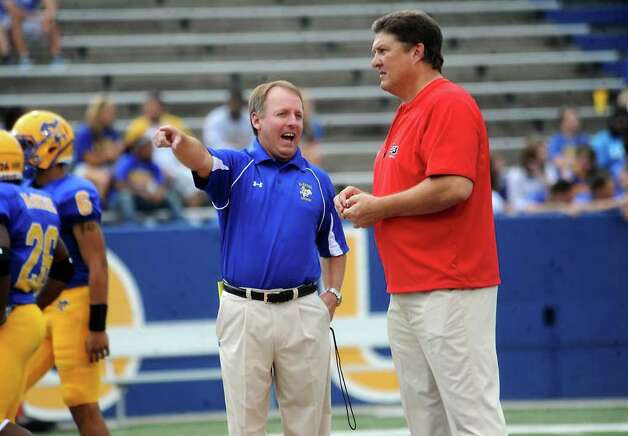 McNeese's coach, Matt Viator and Lamar's coach, Ray Woodard chat before the game at McNeese State College in Lake Charles, Saturday. Tammy McKinley/The Enterprise Photo: TAMMY MCKINLEY / Beaumont