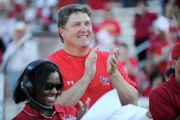 Lamar head football coach Ray Woodard applauds veteran Cardinal football players during a pre-game celebration at Provost Umphrey Stadium honoring players from previous Lamar football teams on October 2. Woodard thinks it's important for Lamar to get competitive quickly and to keep attendance up. Valentino Mauricio/The Enterprise Photo: Valentino Mauricio / Beaumont