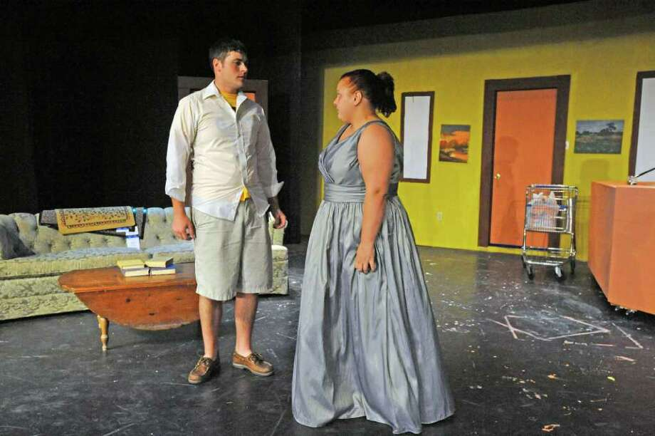 "Daniel Sharpless, right, and Skylar Huckaby, rehearse a scene for the upcoming  production of ""The Boys Next Door"" at the Orange Community Playhouse.  Thursday, August 11, 2011 Valentino Mauricio/The Enterprise Photo: Valentino Mauricio"