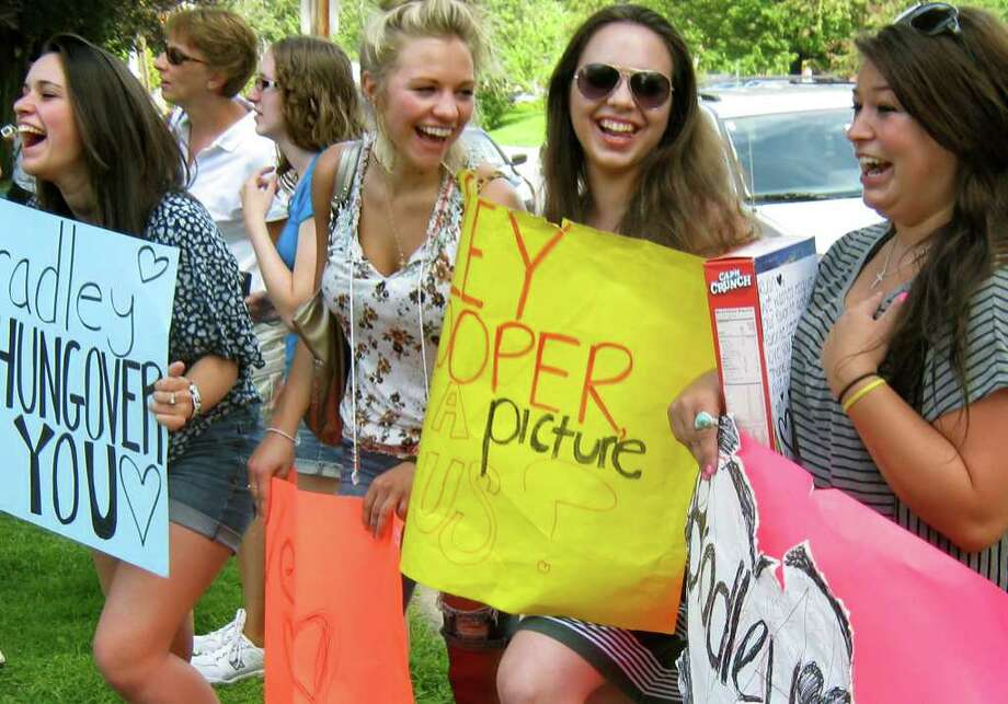 Super fans known as ?the poster girls? are all friends from Schenectady who stalk stars Ryan Gosling and Bradley Cooper and show their love with hand-crafted signs on Tuesday, Aug. 16, 2011, at Faith United Methodist Church in Schenectady, N.Y. They are, from left, Molly McGurn, Jordan Fyvie, Morgan Przekurat, and Stacia Salvatore. (Paul Grondahl / Times Union) Photo: Cindy Schultz / 00014283A