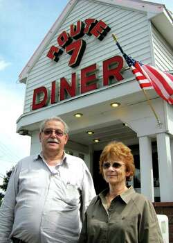 "Diner owner Peter Kounoupis, left, and manager Colleen Noble talk about filming of ""Place Beyond the Pines"" on Tuesday, Aug. 16, 2011, at Route 7 Diner in Latham, N.Y. Eva Mendes, Ryan Gosling and Bradley Cooper were at the diner for three days of shooting. (Paul Grondahl / Times Union archive) Photo: Cindy Schultz / 00014283A"