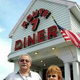 """Diner owner Peter Kounoupis, left, and manager Colleen Noble talk about filming of """"Place Beyond the Pines"""" on Tuesday, Aug. 16, 2011, at Route 7 Diner in Latham, N.Y. Eva Mendes, Ryan Gosling and Bradley Cooper were at the diner for three days of shooting. (Paul Grondahl / Times Union archive)"""