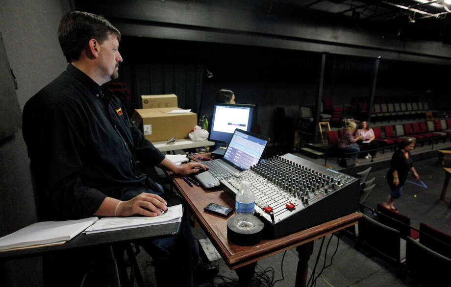 "Chad Miller mans the sound board during a rehearsal for ""Our Town."" KIN MAN HUI / EXPRESS-NEWS / SAN ANTONIO EXPRESS-NEWS"