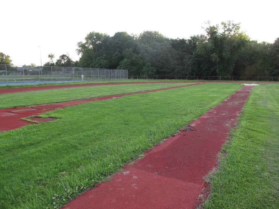 The high school track is deteriorating in several areas and is in need of some serious repair. Photo: Paresh Jha