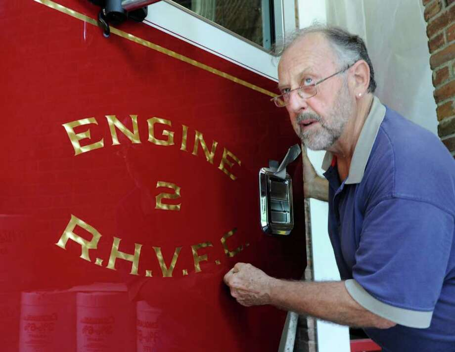 Gold leaf lettering and striping artist Bob Whelan of Valatie, N.Y., at work on the new fire truck inside the Round Hill Volunteer Fire Co., Tuesday afternoon, Aug. 16, 2011. Photo: Bob Luckey / Greenwich Time