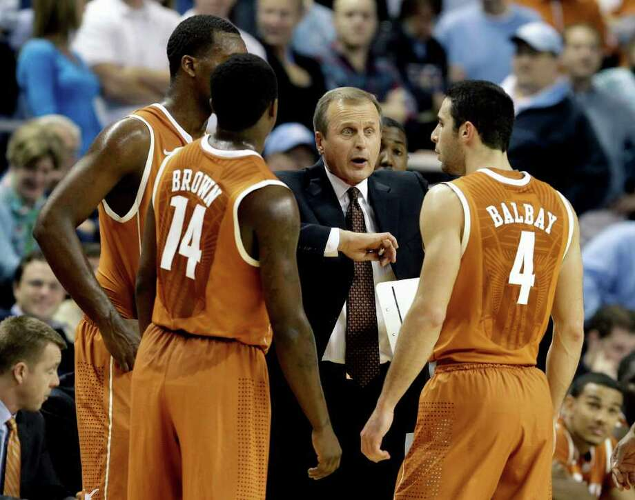 Texas coach Rick Barnes (center) talks to his team during a stop in play against North Carolina in 2010. Barnes hasn't won a title, but players like Kevin Durant, D.J. Augustin and T.J. Ford have turned the national spotlight toward the Erwin Center. Photo: Chuck Burton/Associated Press