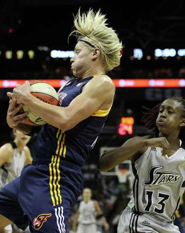 Indiana Fevers' Erin Phillips (13) grabs a rebound against San Antonio SilverStars' Danielle Robinson (13) in the second half at the AT&T Center in San Antonio  on Tuesday, August 16, 2011. Silverstars lose to the Fever, 63-65. Kin Man Hui/kmhui@express-news.net Photo: KIN MAN HUI, -- / San Antonio Express-News