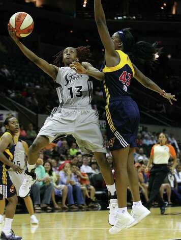 San Antonio SilverStars' Danielle Robinson (13) goes the basket against Indiana Fevers' Shyra Ely (43) in the second half at the AT&T Center in San Antonio  on Tuesday, August 16, 2011. Silverstars lose to the Fever, 63-65. Kin Man Hui/kmhui@express-news.net Photo: KIN MAN HUI, -- / San Antonio Express-News