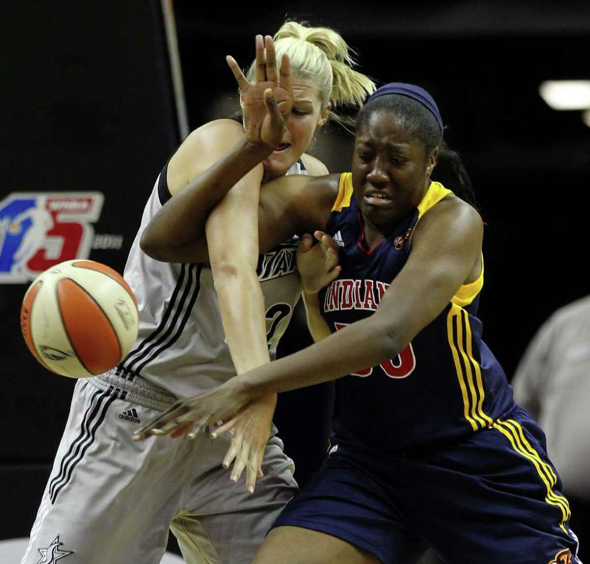 San Antonio SilverStars' Jayne Appel (32) and Indiana Fevers' Jessica Davenport (50) get tangled while attempting to gain control of the ball in the second half at the AT&T Center in San Antonio on Tuesday, August 16, 2011. Silverstars lose to the Fever, 63-65. Kin Man Hui/kmhui@express-news.net