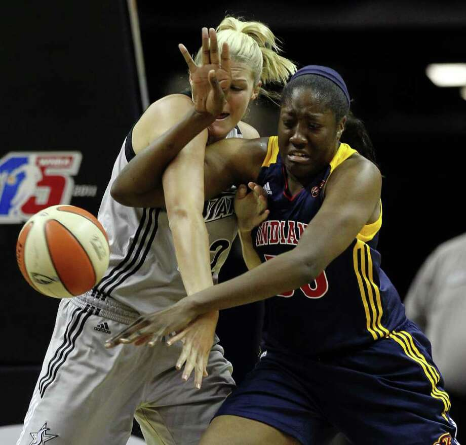 San Antonio SilverStars' Jayne Appel (32) and Indiana Fevers' Jessica Davenport (50) get tangled while attempting to gain control of the ball in the second half at the AT&T Center in San Antonio  on Tuesday, August 16, 2011. Silverstars lose to the Fever, 63-65. Kin Man Hui/kmhui@express-news.net Photo: KIN MAN HUI, -- / San Antonio Express-News